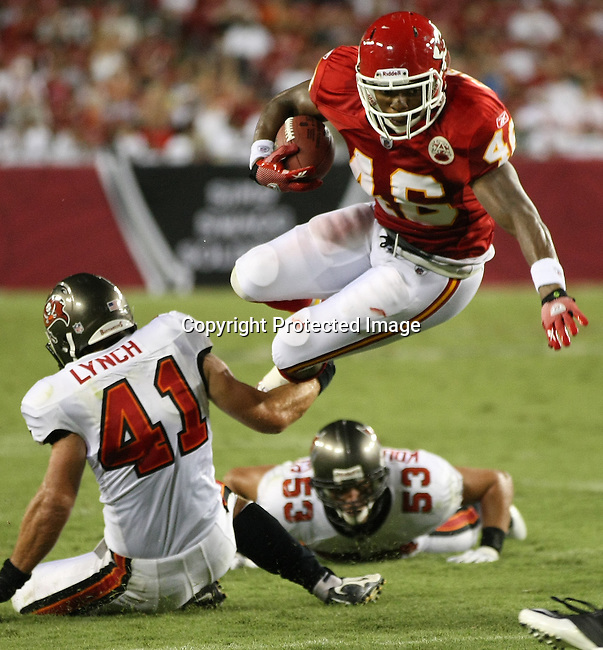 Kansas City Chief's running back Tim Castille leaps forward for a first down against the Tampa Bay Buccaneers. The Buccaneers defeated the Chiefs  20-15 during an NFL preseason game Saturday, Aug. 21, 2010 in Tampa,Fla. (AP Photo/Margaret Bowles).