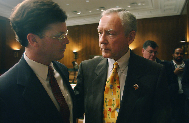"3/14/02.PICKERING NOMINATION--Just after the rejection of the nomination by Senate Judiciary of Charles W. Pickering Sr. to be United States Circuit Court Judge for the 5th Circuit, his son, U.S. Rep. Charles W. ""Chip"" Pickering Jr., R-Miss., left, and committee ranking Republican Orrin G. Hatch, R-Utah, console each other..CONGRESSIONAL QUARTERLY PHOTO BY SCOTT J. FERRELL"