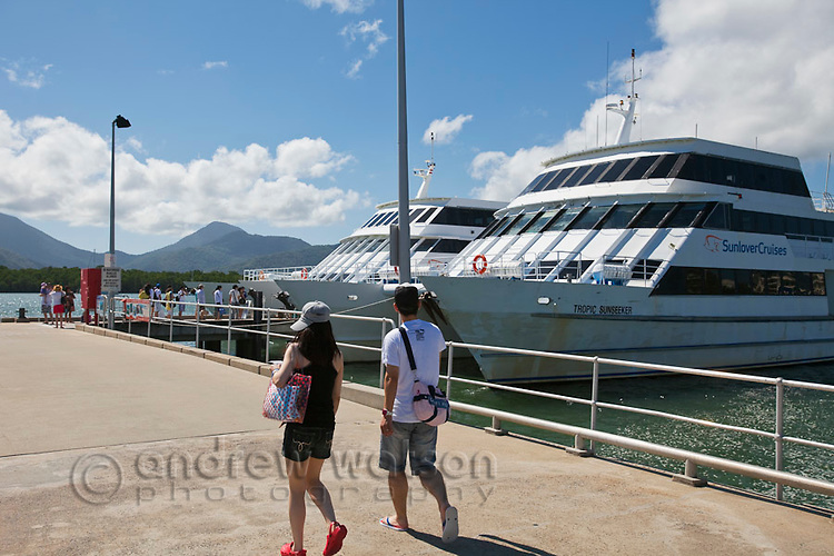 Couple walking along Marlin Marina jetty.  Cairns, Queensland, Australia