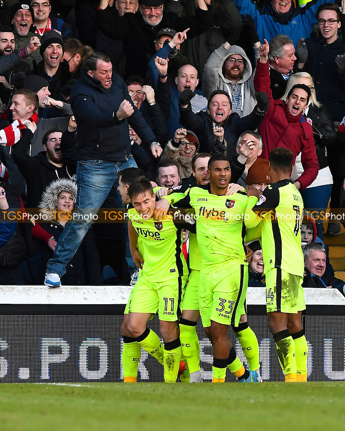 David Wheeler of Exeter City (left) celebrates his goal with the Exeter fans during Portsmouth vs Exeter City, Sky Bet EFL League 2 Football at Fratton Park on 28th January 2017