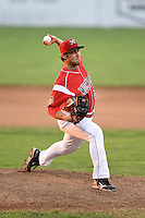 Batavia Muckdogs pitcher Sam Alvis (22) delivers a pitch during a game against the Auburn Doubledays on June 16, 2014 at Dwyer Stadium in Batavia, New York.  Batavia defeated Auburn 4-3.  (Mike Janes/Four Seam Images)