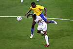01 July 2006: Juan Riquelme (BRA) (4) goes through and over Louis Saha (FRA) (14) for the ball. France defeated Brazil 1-0 at Commerzbank Arena in Frankfurt, Germany in match 60, a Quarterfinal game of the 2006 FIFA World Cup.