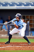 Charlotte Stone Crabs second baseman Kean Wong (4) squares to bunt during a game against the Dunedin Blue Jays on July 26, 2015 at Charlotte Sports Park in Port Charlotte, Florida.  Charlotte defeated Dunedin 2-1 in ten innings.  (Mike Janes/Four Seam Images)