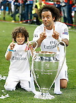 Real Madrid's Marcelo Vieira celebrates with his son the victory in the UEFA Champions League 2015/2016 Final match.May 28,2016. (ALTERPHOTOS/Acero)