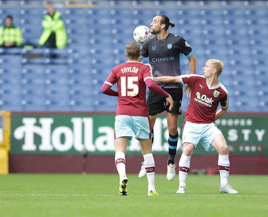 Sheffield Wednesday's Atdhe Nuhiu battles with Burnley's Ben Mee (right) and Matthew Taylor<br /> <br /> Photographer Stephen White/CameraSport<br /> <br /> Football - The Football League Sky Bet Championship - Burnley v Sheffield Wednesday - Saturday 12th September 2015 -  Turf Moor - Burnley<br /> <br /> &copy; CameraSport - 43 Linden Ave. Countesthorpe. Leicester. England. LE8 5PG - Tel: +44 (0) 116 277 4147 - admin@camerasport.com - www.camerasport.com