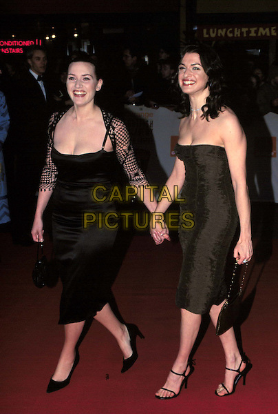 KATE WINSLET & RACHEL WEISZ..Arrivals at The BAFTAS..holding hands, black dress, strapless, full length, full-length..www.capitalpictures.com..sales@capitalpictures.com..©Capital Pictures..