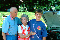 Grandparents and grandson preparing for family trip age 80 and 13.  St Paul Minnesota USA