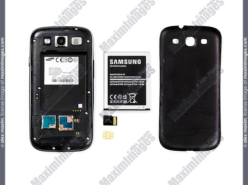 Samsung Android phone with the rear cover removed and battery, memory and SIM card taken out isolated on white background
