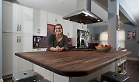 NWA Democrat-Gazette/DAVID GOTTSCHALK   Shawn House leans on the butcher block countertop Friday, August 11, 2017, in her favorite personal space, the remodeled kitchen in her Fayetteville home.