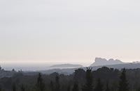 View from Domaine de la Tour du Bon the Mediterranean sea and the Bec de l'Aigle rock in La Ciotat can be seen in a haze in the distance. The cliffs Bec de l'Aigle, the eagles beak Domaine de la Tour du Bon Le Castellet Bandol Var Cote d'Azur France