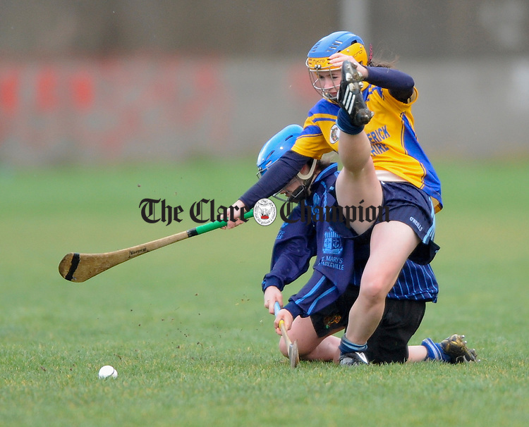 St Caimins Rachel O Halloran kicks the ball away during their junior A schools Munster camogie final against St Mary's at LIT. Photograph by John Kelly.