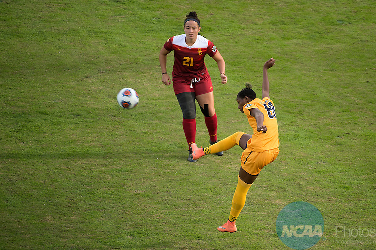 SAN JOSE, CA - DECEMBER 04:  Kadeisha Buchanan (88) of West Virginia University jumps for the ball against Alex Anthony (21) of the University of Southern California during the Division I Women's Soccer Championship held at Avaya Stadium on December 04, 2016 in San Jose, California.  USC defeated West Virginia 3-1 for the national title. (Photo by Jamie Schwaberow/NCAA Photos via Getty Images)