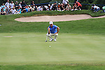Graeme McDowell lines up his putt on the 13th on the final day of the Celtic Manor Wales Open 2010.Picture Fran Caffrey/Newsfile.ie