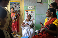 A health worker, centre, prepares to immunize a child at an Aanganwadi, a government family health centre in Rangsaipet, in Waragal, Telangana, Indiia, on Saturday, February 9, 2019. Photographer: Suzanne Lee for Safe Water Network
