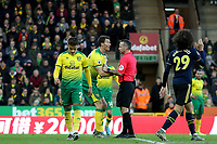1st December 2019; Carrow Road, Norwich, Norfolk, England, English Premier League Football, Norwich versus Arsenal; Christoph Zimmermann of Norwich City speaks with the referee as he awards Arsenal a penalty - Strictly Editorial Use Only. No use with unauthorized audio, video, data, fixture lists, club/league logos or 'live' services. Online in-match use limited to 120 images, no video emulation. No use in betting, games or single club/league/player publications