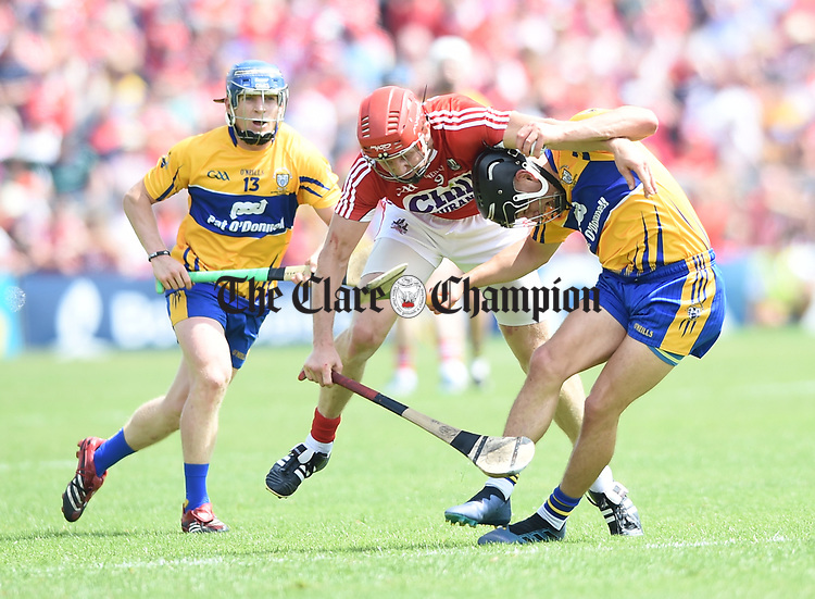 Bill Cooper of Cork in action against David Reidy of Clare during their Munster senior hurling final at Thurles. Photograph by John Kelly.