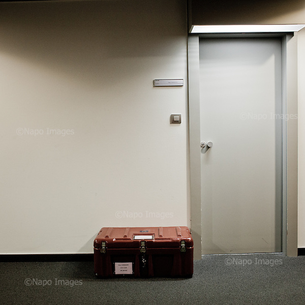 STRASBOURG, FRANCE, NOVEMBER 24, 2014: At the European Parliament, individual containers called &quot;cantines&quot;, in which the documents are transported between European sites in Brussels, Strasbourg and Luxembourg, sit by the office door, waiting  for their owners to arrive. Every month thousands of parliament's employees travel back and forth between the towns. (Photo by Piotr Malecki / Napo Images)  <br /> STRASBURG, FRANCJA, 24/11/2014: Pod drzwiami biur w siedzibie Parlamentu Europejskiego leza indywidualne walizki uzywane do transportowania dokumentow pomiedzy siedzibami PE w Brukseli, Strasburgu i Luksemburgu. Kazdego miesiaca tysiace pracownikow parlamentu podrozuje miedzy siedzibami w Brukseli, Strasburgu i Luksemburgu. Fot: Piotr Malecki / Napo Images