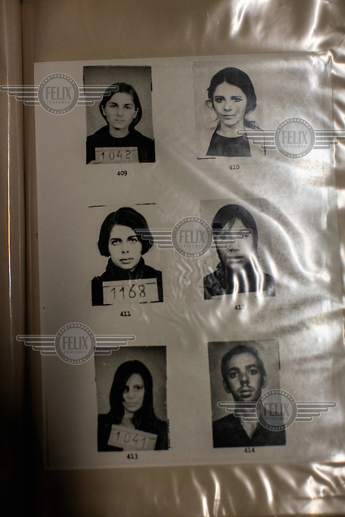 Pictures in the archives at the State Department of Political and Social Order (DEOPS) for the State Secretary of Culture. The archives hold all investigations of civilians, social groups and social movements during the 20-year dictatorship (1 April, 1964 to 15 March, 1985) and includes images of thousands of people arrested on charges of subversion. <br /> <br /> There are 13,500 folders or about 1.5km of documents when laid out. The red folders hold general information such as newspapers and books. The blue folders hold investigations of monitored social organisations and movements, including photographs of individuals. There are also folders of individuals who were investigated and monitored during the dictatorship.