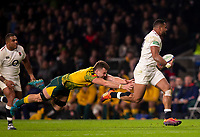 England's Joe Cokanasiga evades the tackle of Australia's Jack Maddocks<br /> <br /> Photographer Bob Bradford/CameraSport<br /> <br /> 2018 Quilter Internationals - England v Australia - Saturday 24th November 2018 - Twickenham - London<br /> <br /> World Copyright &copy; 2018 CameraSport. All rights reserved. 43 Linden Ave. Countesthorpe. Leicester. England. LE8 5PG - Tel: +44 (0) 116 277 4147 - admin@camerasport.com - www.camerasport.com