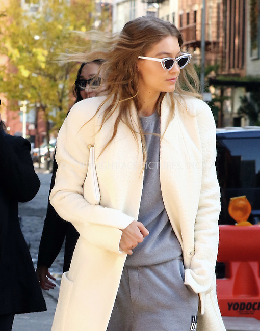 www.acepixs.com<br /> <br /> November 1 2016, New York City<br /> <br /> Model Gigi Hadid wears a long cream coat as she goes for a walk in her East Village neighborhood on November 1 2016 in New York City<br /> <br /> By Line: Zelig Shaul/ACE Pictures<br /> <br /> <br /> ACE Pictures Inc<br /> Tel: 6467670430<br /> Email: info@acepixs.com<br /> www.acepixs.com