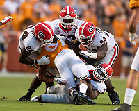 KNOXVILLE, TN - OCTOBER 5: Walter Grant #84, Michael Barnett #94 and Monty Rice #32 of the Georgia Bulldogs gang tackle Ty Chandler #8 of the Tennessee Volunteers during a game between University of Georgia Bulldogs and University of Tennessee Volunteers at Neyland Stadium on October 5, 2019 in Knoxville, Tennessee.