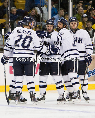 (Kostolansky), Blake Kessel (UNH - 20), Mike Sislo (UNH - 19), Phil DeSimone (UNH - 39), Paul Thompson (UNH - 17) celebrate before officials ruled no goal following review. - The Merrimack College Warriors defeated the University of New Hampshire Wildcats 4-1 (EN) in their Hockey East Semi-Final on Friday, March 18, 2011, at TD Garden in Boston, Massachusetts.