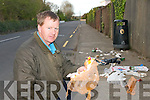 RUBBISH: Peter O'Connor, chairman of Currow/Currans Rural Development with some of the rubbish discarded in Currow Village on Monday.   Copyright Kerry's Eye 2008