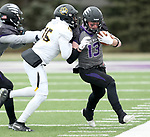 SIOUX FALLS, SD - NOVEMBER 10: A.J. Garrow #13 from the University of South Falls is pushed out of bounds bye J'Von France #15 from Wayne State during their game Saturday afternoon at Bob Young Field in Sioux Falls. (Photo by Dave Eggen/Inertia)