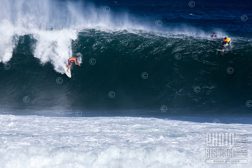 A surfer rides a big wave at Pipeline (off of 'Ehukai Beach Park), North Shore, O'ahu.