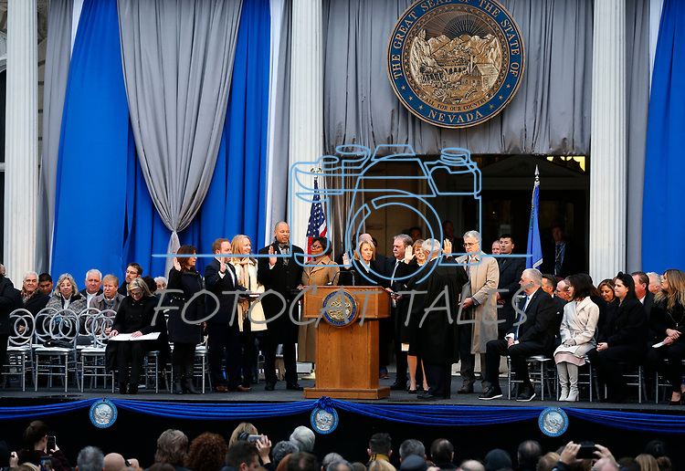Nevada Supreme Court Chief Justice James Hardesty delivers the oath of office to Constitutional officers, from left, Controller Catherine Byrne, Treasurer Zach Conine, Attorney General Aaron Ford, Secretary of State Barbara Cegavske and Lt. Governor Kate Marshall during the inauguration at the Capitol, in Carson City, Nev., on Monday, Jan. 7, 2019. (Cathleen Allison/Las Vegas Review-Journal)