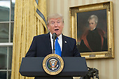 US President Donald J. Trump speaks before Rex Tillerson (not pictured) was sworn-in as US Secretary of State in the Oval Office of the White House in Washington, DC, USA, 01 February 2017. Tillerson was confirmed by the Senate, 01 February, in a 56-to-43 vote to become the nation's 69th Secretary of State.<br /> Credit: Michael Reynolds / Pool via CNP