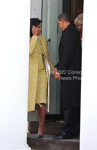 Washington, DC - January 20, 2009 -- United States President-elect Barack Obama and Michelle Obama depart St. John's Church en route to the White Hose for the traditional tea with the Bushs in Washington, D.C. on Tuesday, January 20, 2009..Credit: Ron Sachs - Pool via CNP