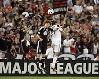 Carey Talley #8 of D.C. United goes up for a header against Alan Gordon #21 of the Los Angeles Galaxy during an MLS match at RFK Stadium on July 18 2010, in Washington D.C. Galaxy won 2-1.