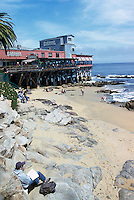 """Beach and Restaurant along Monterey Bay at Steinbeck Plaza, along """"Cannery Row"""", in the City of Monterey, California, USA"""