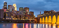 Minneapolis, Minnesota skyline and Stone Arch Bridge at dusk.
