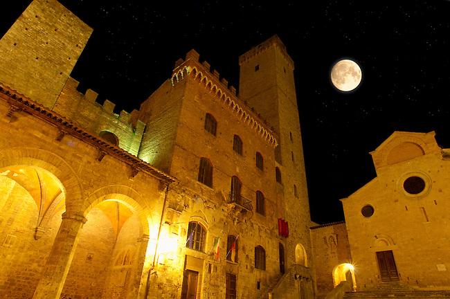 Medieval houses at night around Plazza Duomo - San Gimignano - Italy