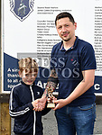 Ardee Celtic's U-10 player of the year Aodhan Gibbins with U-10 coach Paul McCormack. Photo:Colin Bell/pressphotos.ie