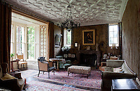Aubusson tapestries line the walls of the drawing room, also home to a wistful portrait of Nora Parsons