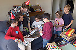 El Cerrito Ca Mother and guests, ages five to nine, observing opening of five-year-old's birthday presents  MR