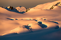 Sunset light on Explorer Glacier and crevasses in upper parts of Fox Glacier NEVE, Westland Tai Poutini National Park, West Coast, UNESCO World Heritage Area, New Zealand, NZ