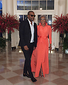 Lee Daniels, Actor and Filmaker and Clara Daniels arrive  the State Dinner for China's President President Xi and Madame Peng Liyuan at the White House in Washington, DC for an official State Visit Friday, September 25, 2015. Credit: Chris Kleponis / CNP