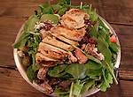 Jerry Conner runs the Fire-N-Smoke Restaurant in Troy, where all the meats are wood-fire-cooked. The automatic smoker grill can hold 500 pounds of meat at a time, including brisket, pork butts, chickens and turkeys. This salad has strips of wood-fire-cooked chicken on it.