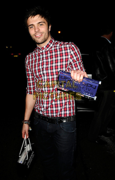 DALE HOWARD.Digital Spy Reality TV Awards at the Bloomsbury Ballroom, London, England.  .April 6th, 2009.half length red white check checked shirt award trophy stubble facial hair goody bag full 3/4.CAP/CAN.©Can Nguyen/Capital Pictures.