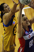 Pulse goal attack Paula Griffin and Mystics goal defence Stephanie Bond compete for the ball during the ANZ Netball Championship match between the Central Pulse and Northern Mystics, TSB Bank Arena, Wellington, New Zealand on Monday, 4 May 2009. Photo: Dave Lintott / lintottphoto.co.nz
