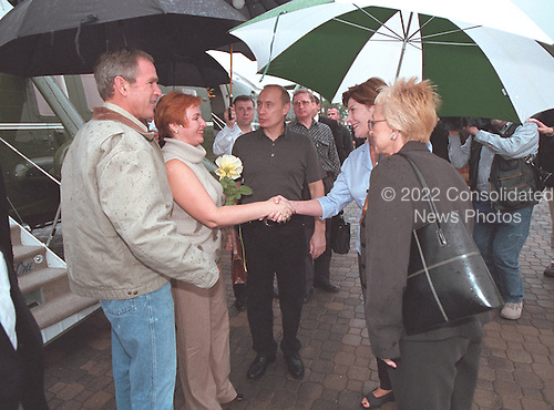 First Lady Laura Bush, right, greets Russian First Lady Lyudmila Putin with United States President George W. Bush and President Vladimir Putin of Russia during their arrival at the Bush Ranch in Crawford, Texas, Wednesday, November 14, 2001. .Mandatory Credit: Eric Draper / White House via CNP