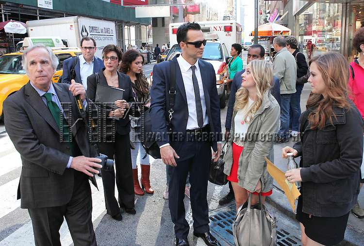 "The cast and creative team of ""The Performers"", from left, actor Henry Winkler, producer Scott M. Delman, producer Robyn Goodman, Amanda Lipitz, actress Ari Graynor, actor Cheyenne Jackson, actor Daniel Breaker, actress Jenni Barber and actress Alicia Silverstone  walk through Times Square to view '""The Performers"" theatre marquee on Tuesday, Sept. 25, 2012 in New York."