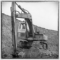 Former TD, Jackie Healy-Rae, pictured driving a digger in a pit in 1981. The Healy-Rae name is synonymous with plant hire..Picture by Don macMonagle Jackie Healy-Rae, TD from the book by Don MacMonagle entitled 'Jackie - Keeping Up Appearances' published in 2002.