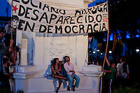A couple rest during a Demonstration led by the 'Madres de Plaza de Mayo'  to commemorate the 37th anniversary of the coup of 1976, at Plaza de Mayo square in Buenos Aires on March 24, 2013. Photo by Juan Gabriel Lopera / VIEWpress.