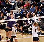 SIOUX FALLS, SD - OCTOBER 14: Michelle Ritland #12 from the University of Sioux Falls winds up for a kill against Ashley Wilson #10 from Augustana in the second game of their match Tuesday night at the Elmen Center. (Photo by Dave Eggen/Inertia)