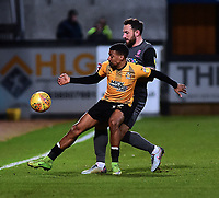 Cambridge United's Reggie Lambe shields the ball from  Lincoln City's Neal Eardley<br /> <br /> Photographer Andrew Vaughan/CameraSport<br /> <br /> The EFL Sky Bet League Two - Cambridge United v Lincoln City - Saturday 29th December 2018  - Abbey Stadium - Cambridge<br /> <br /> World Copyright © 2018 CameraSport. All rights reserved. 43 Linden Ave. Countesthorpe. Leicester. England. LE8 5PG - Tel: +44 (0) 116 277 4147 - admin@camerasport.com - www.camerasport.com